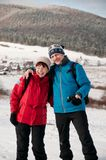 Senior retired couple in winter together. Lifestyle portrait of senior happy retired couple in outdoor winter together Stock Image