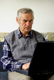 Senior, retired man. Acquainted with the Internet Royalty Free Stock Photos