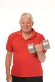 Senior retired man exercising Royalty Free Stock Images
