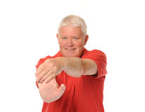 Senior retired man stretching. Senior retired older man stretching on white background Royalty Free Stock Images
