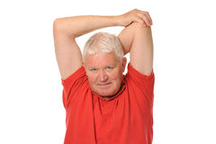 Senior retired man stretching. Senior retired older man stretching on white background Royalty Free Stock Image