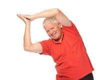 Senior retired man stretching. Senior retired older man stretching on white background Stock Images