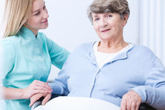 Senior rich lady and carer Royalty Free Stock Photos
