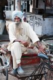 Senior rickshaw is waiting for passengers Stock Photos