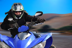 Senior rides a quad bike Royalty Free Stock Photo