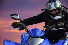 Senior rides a quad bike Stock Image