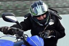 Senior rides a quad bike Royalty Free Stock Photos