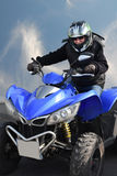 Senior rides a quad bike Royalty Free Stock Images