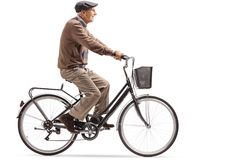 Senior riding a bicycle. Isolated on white background stock photo