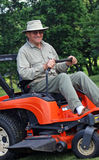 Senior on Riding Mower Stock Image