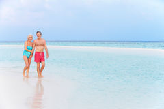 Senior Romantic Couple Walking In Beautiful Tropical Sea Stock Photos