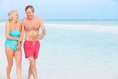 Senior Romantic Couple Walking In Beautiful Tropical Sea Royalty Free Stock Images