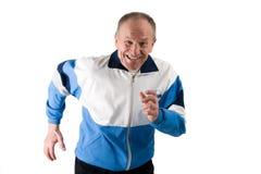 Senior runner. Active senior in a sportsuit running Stock Photography