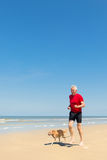 Senior runner at the beach Royalty Free Stock Images