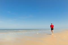 Senior runner at the beach Stock Image