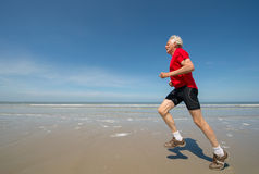 Senior runner at the beach Royalty Free Stock Photo