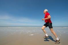 Senior runner at the beach Royalty Free Stock Photo