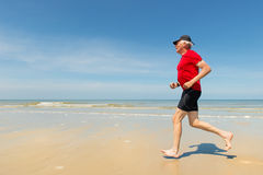 Senior runner at the beach Royalty Free Stock Image