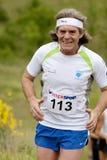 Senior runner with headband. PAVIE, FRANCE - MAY 22, 2011: man runner with headband at the Trail of Pavie, on May 22, 2011, in Pavie, France stock photos