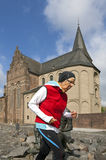 Senior runner and historic church building Stock Image