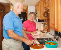 Senior RV - Helping in the Kitchen Royalty Free Stock Photos