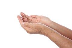 Senior's hand seeking Stock Photography