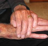 Senior's hands stock images