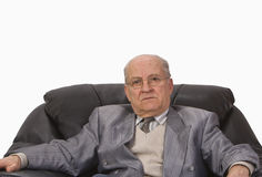 A senior's portrait. Portrait of a senior man sitting in an armchair.Shot with Canon 70-200mm f/2.8L IS USM Royalty Free Stock Photos