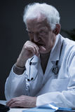 Senior sad physician Royalty Free Stock Photography