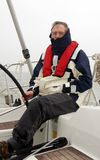 Senior sailor. During foggy and cold weather royalty free stock image