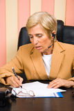 Senior sales representative taking notes. Senior sales representative woman taking notes and working,check also Business people Stock Photo