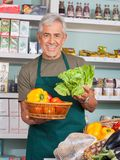 Senior Salesman Selling Vegetables In Store Royalty Free Stock Photos