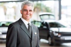 Senior salesman. Senior vehicle salesman working at a car dealer stock images