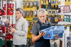 Senior Salesman Working In Hardware Store Royalty Free Stock Image