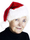 Senior santa. Senior woman portrait with santa hat on white background stock images