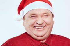 Senior in Santa Claus hat Stock Photo