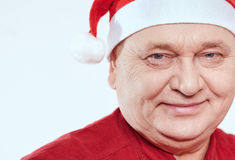 Senior in Santa Claus hat Stock Photography