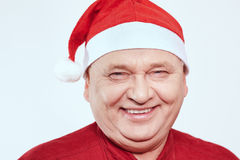 Senior in Santa Claus hat Stock Image