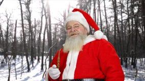 Senior Santa Claus smoking his pipe outdoors. stock footage