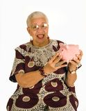 Senior Savor. Shot of a senior African American Woman who is excited about her savings account stock photo