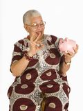 Senior Savor. Shot of a senior African American Woman who is satisfied with her savings account Royalty Free Stock Photo