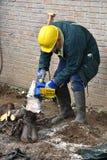 Senior sawing Royalty Free Stock Images