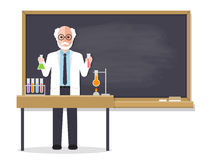 Senior science teacher teaching student in classroom Royalty Free Stock Images