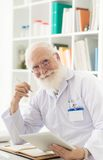 Senior scientist at his workplace Stock Photos