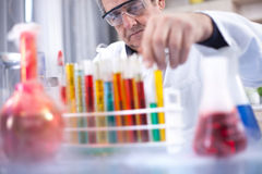 senior scientist with protective glasess researching in laboratory royalty free stock photo