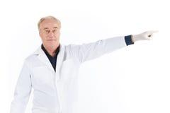 Senior scientist standing on white background. Stock Photos