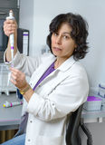 Senior scientist works with automatic pipette, Stock Photos