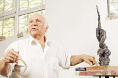 Senior sculptor describing his sculpture Stock Photos