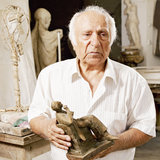 Senior sculptor holding his sculpture Stock Image