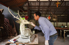 Senior sculptors work on his sculpture in his workshop Royalty Free Stock Photo